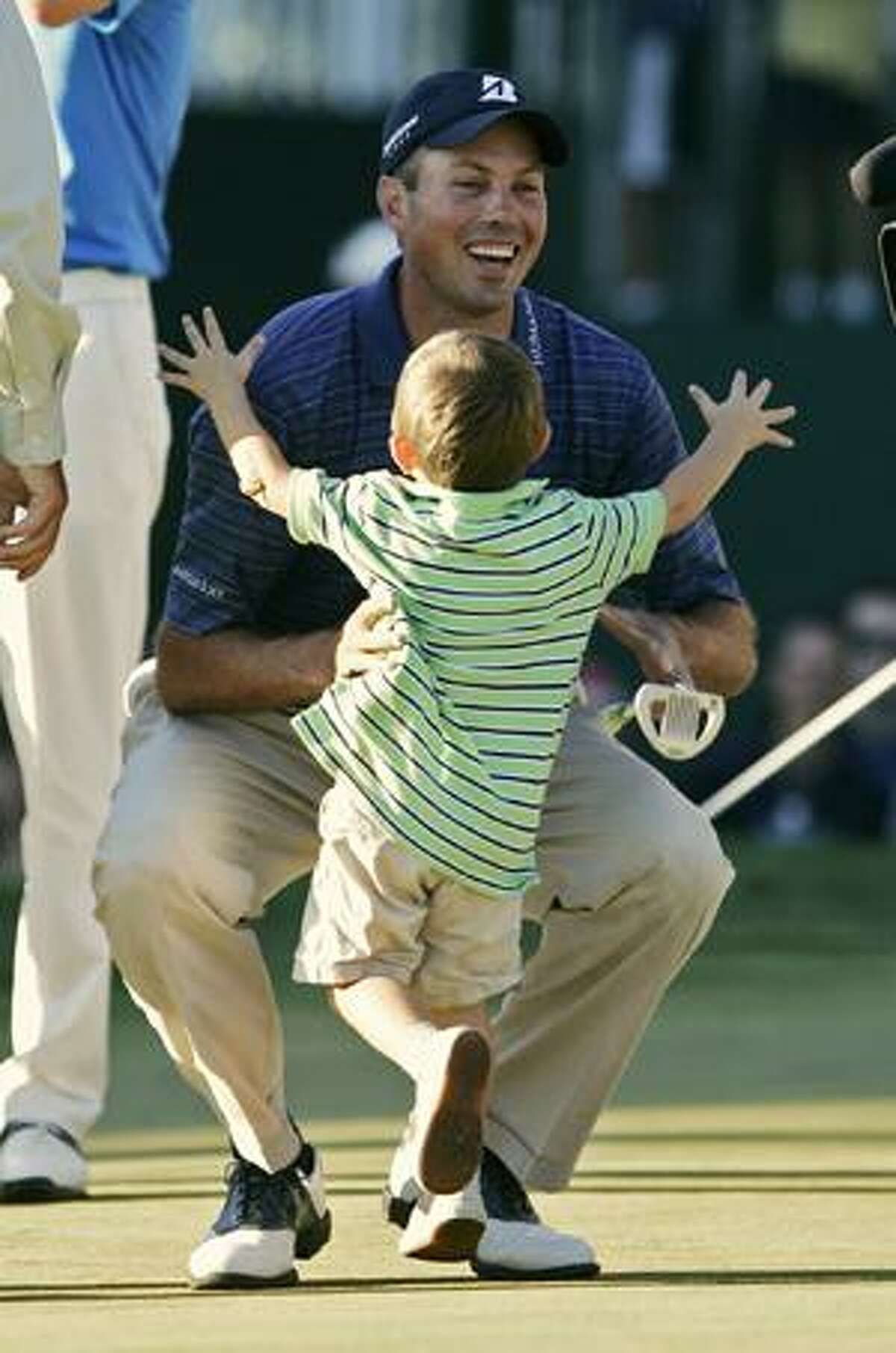 AP Cameron Kuchar, 2, runs into his arms of his father, Matt Kuchar, after Kuchar beat Martin Laird of Scotland in a sudden death playoff at The Barclays golf tournament, Sunday, in Paramus, N.J. Kuchar won with a score of 12-under par.