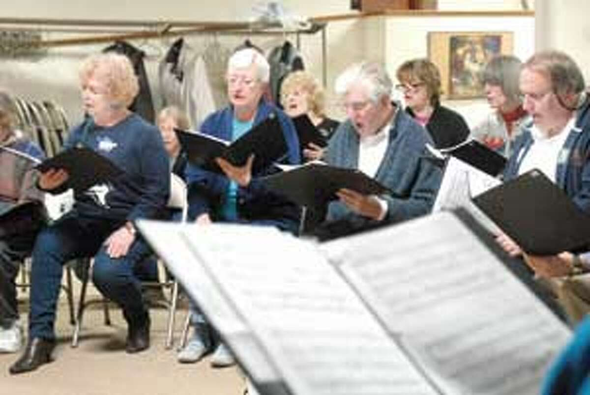 Members of the Connecticut Yankee Chorale sing during a recent rehearsal. The group presents its 25th anniversary Spring Concert this Sunday at 3:00 p.m. at First United Methodist Church in Torrington. Purchase a glossy print of this photo and more at www.registercitizen.com.