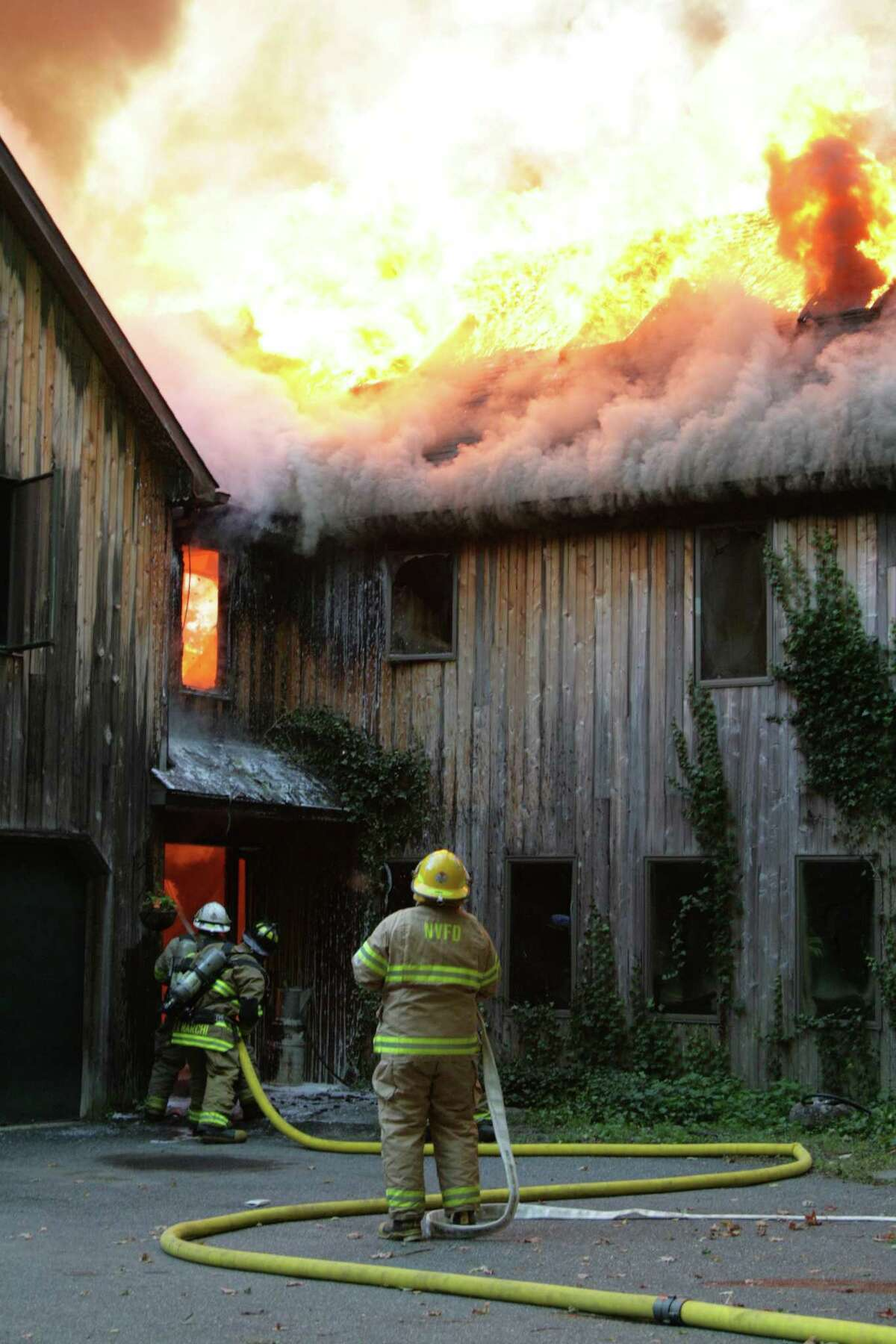 Courtesy of Jonathan Barbagallo/ Firemen respond to a structural fire in Colebrook early Monday morning.