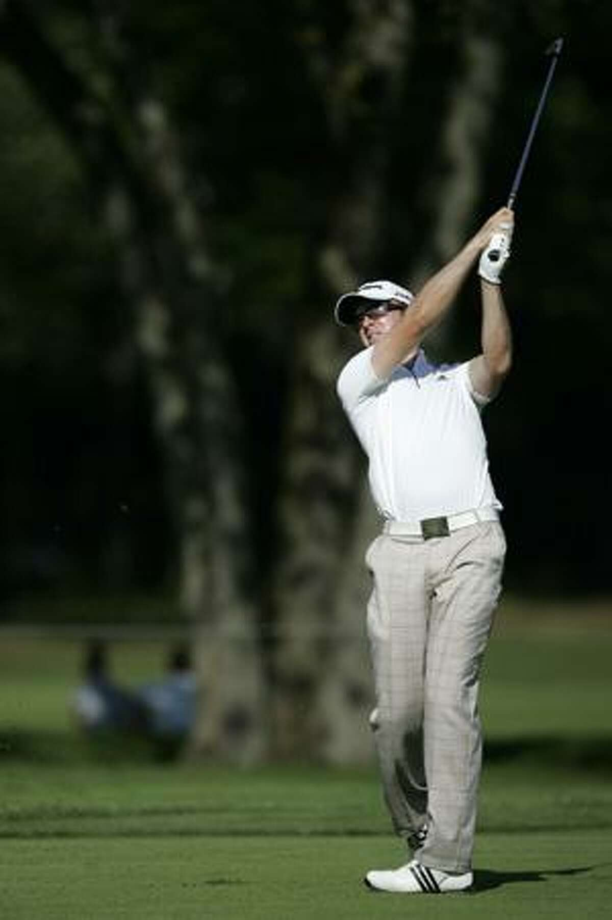 AP Martin Laird of Scotland, watches his shot from the 14th fairway to avoid a tree while playing the 13th hole during the third round of The Barclays golf tournament, Saturday, in Paramus, N.J.