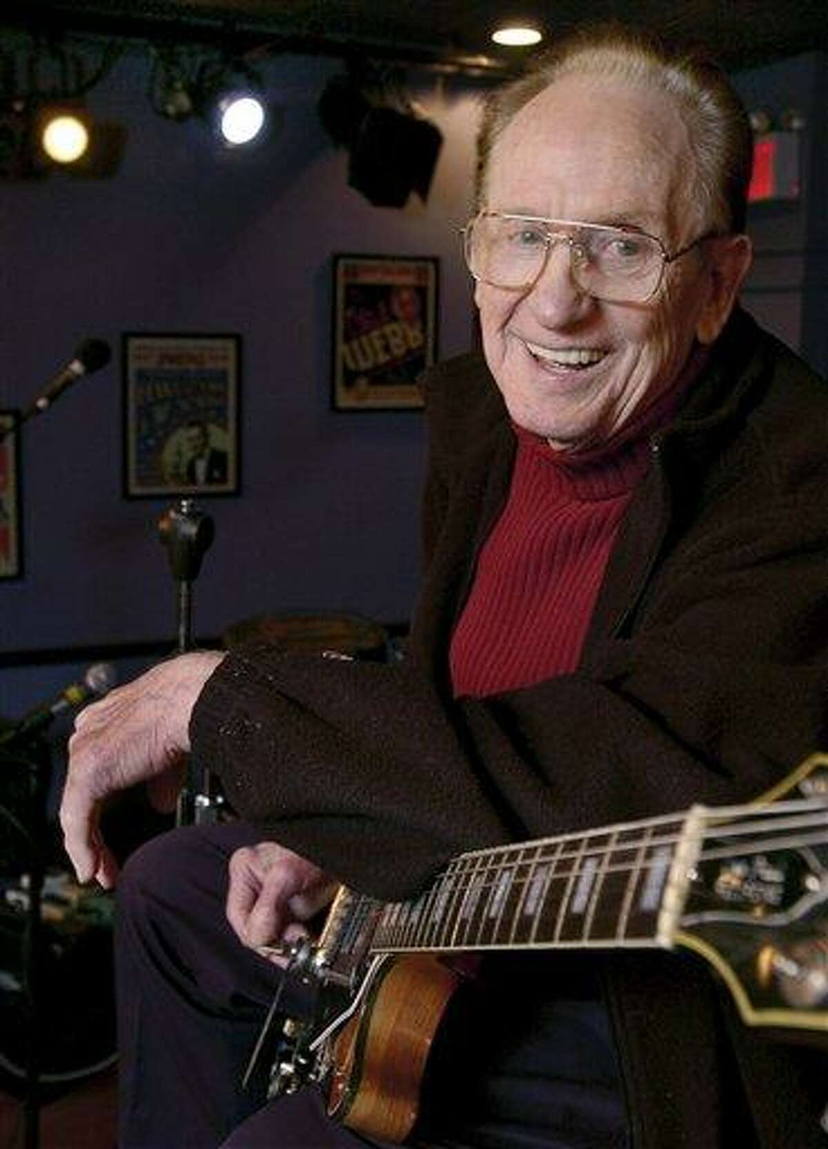 FILE - In this Oct. 4, 2004 file photo, guitar legend Les Paul gets ready to rehearse at the Iridium Jazz Club in New York. Paul, 94, the guitarist and inventor who changed the course of music with the electric guitar and multitrack recording and had a string of hits, died, Thursday, Aug. 13, 2009 in White Plains, N.Y., according to Gibson Guitar. (AP Photo/Richard Drew, file)