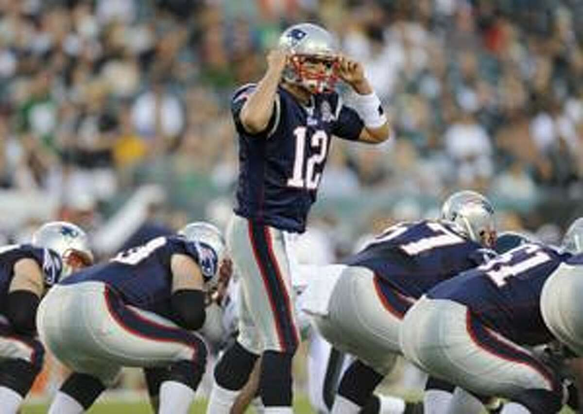 New England Patriots quarterback Tom Brady calls a play in the first quarter of an NFL preseason football game against the Philadelphia Eagles Thursday in Philadelphia.