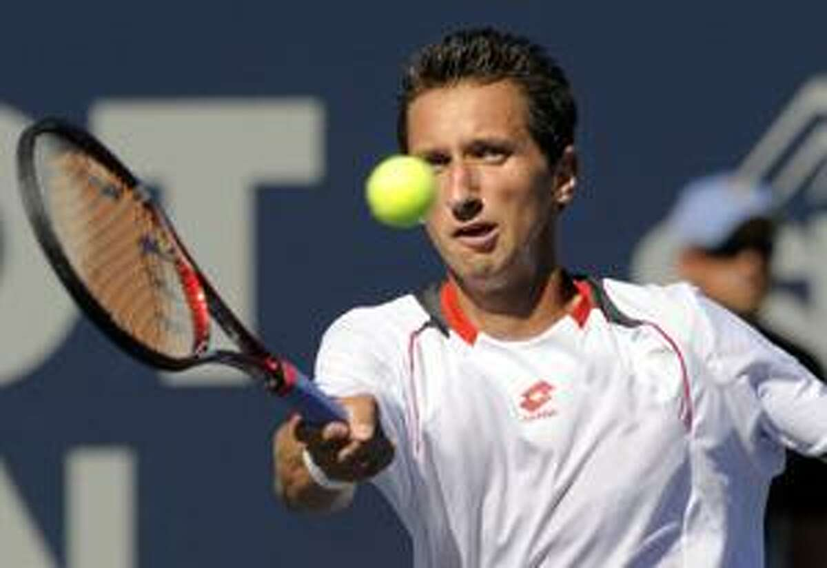 Sergiy Stakhovsky, of Ukraine, hits a forehand volley during his semifinal match against Thiemo de Bakker, The Netherlands, at the Pilot Pen tennis tournament in New Haven, Conn., on Friday, Aug. 27, 2010. (AP Photo/Fred Beckham)