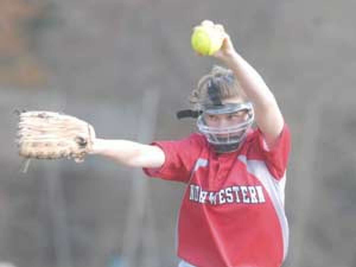 Northwestern's Brittany Martel winds up during Tuesday's game with Gilbert at Walker Field in Winsted. Purchase a glossy print of this photo and more at www.registercitizen.com.