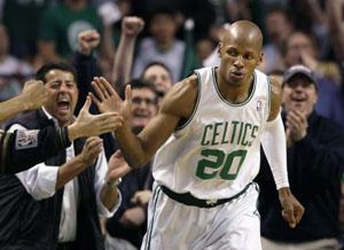AP Boston Celtics guard Ray Allen (20) slaps hands with a fan after shooting a 3-point basket against the Miami Heat during the second quarter of Game 2 in a first-round NBA playoff series in Boston on Tuesday. The Celtics won 106-77.