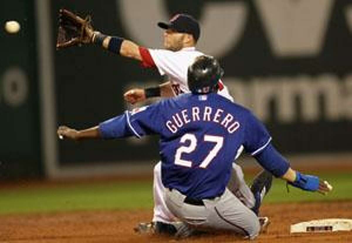 AP Boston Red Sox second baseman Dustin Pedroia takes a late throw as Texas Ranger Vladimir Guerrero slides in safely into second during the third inning of Tuesday's game at Fenway Park in Boston. Boston won 7-6.
