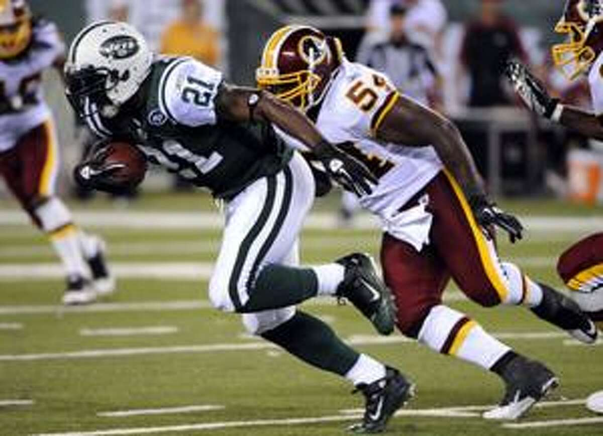 New York Jets running back LaDainian Tomlinson (21) runs away from Washington Redskins linebacker H.B. Blades (54) during the second quarter of an NFL preseason football game at New Meadowlands Stadium in East Rutherford, N.J., Friday, Aug. 27, 2010. (AP Photo/Bill Kostroun)