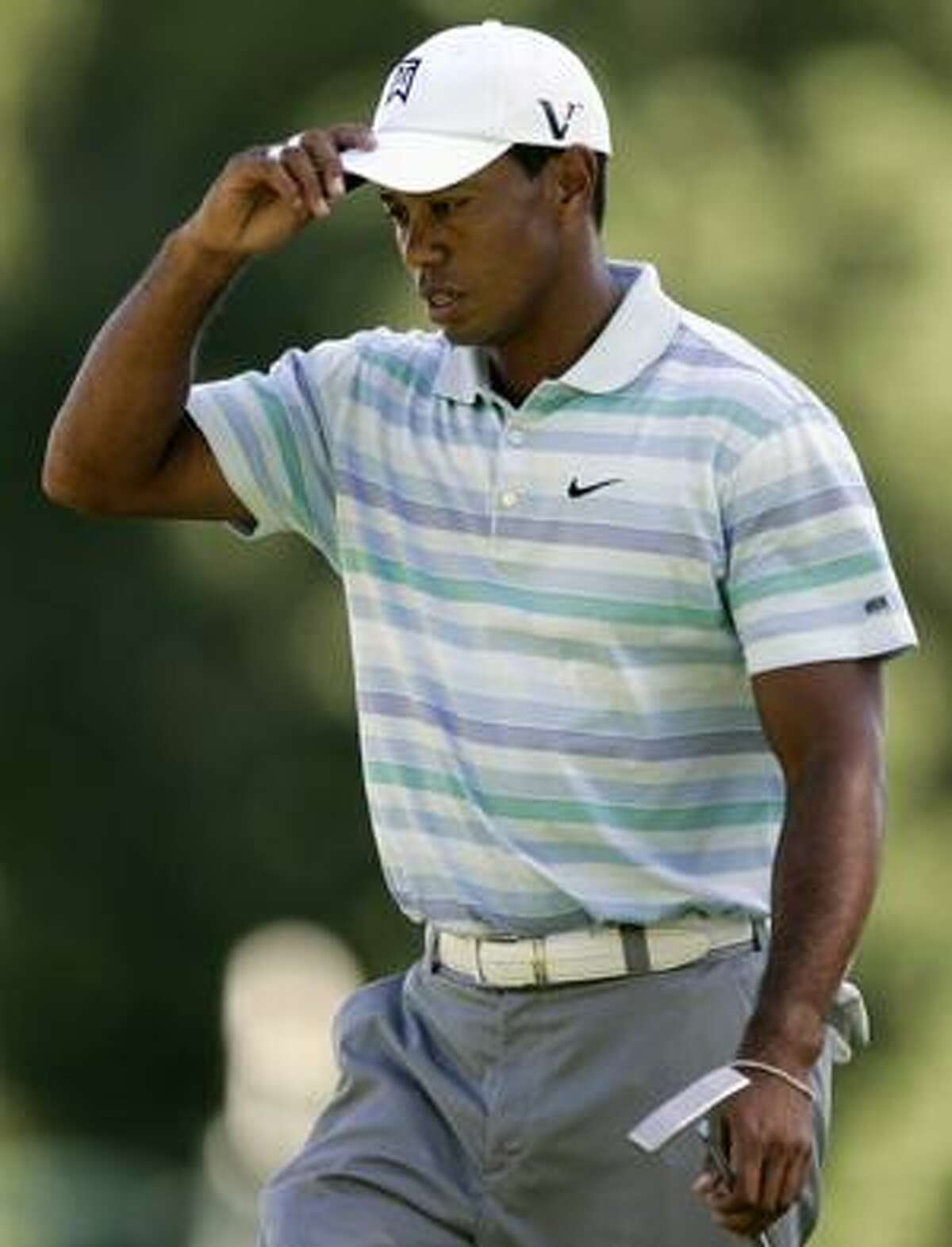 Tiger Woods looks dejected as he walks off the ninth hole after four bogeys on the back nine during the second round of The Barclays golf tournament, Friday, Aug. 27, 2010, in Paramus, N.J. (AP Photo/Rich Schultz)