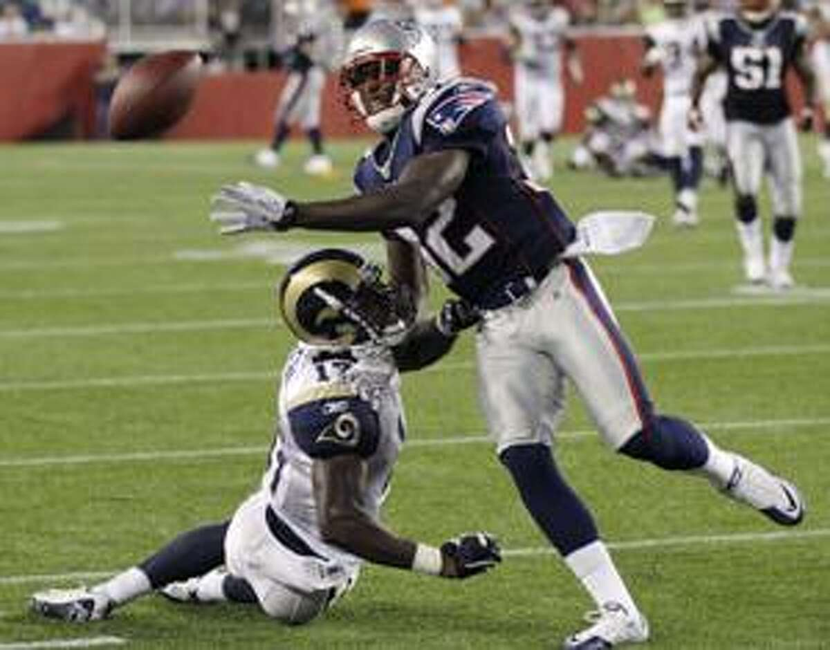 New England Patriots cornerback Devin McCourty, right, breaks up a pass as St. Louis Rams wide receiver Donnie Avery, left, falls to the turf in the second quarter during an NFL preseason football game Thursday, Aug. 26, 2010, in Foxborough, Mass. Avery was injured on the play and left the game. (AP Photo/Charles Krupa)