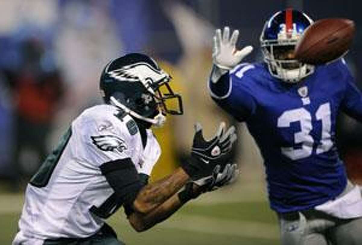 Philadelphia Eagles wide receiver DeSean Jackson (10) catches a pass behind New York Giants cornerback Aaron Ross (31) and runs it into the end zone for a touchdown during the third quarter Sunday in East Rutherford, N.J.