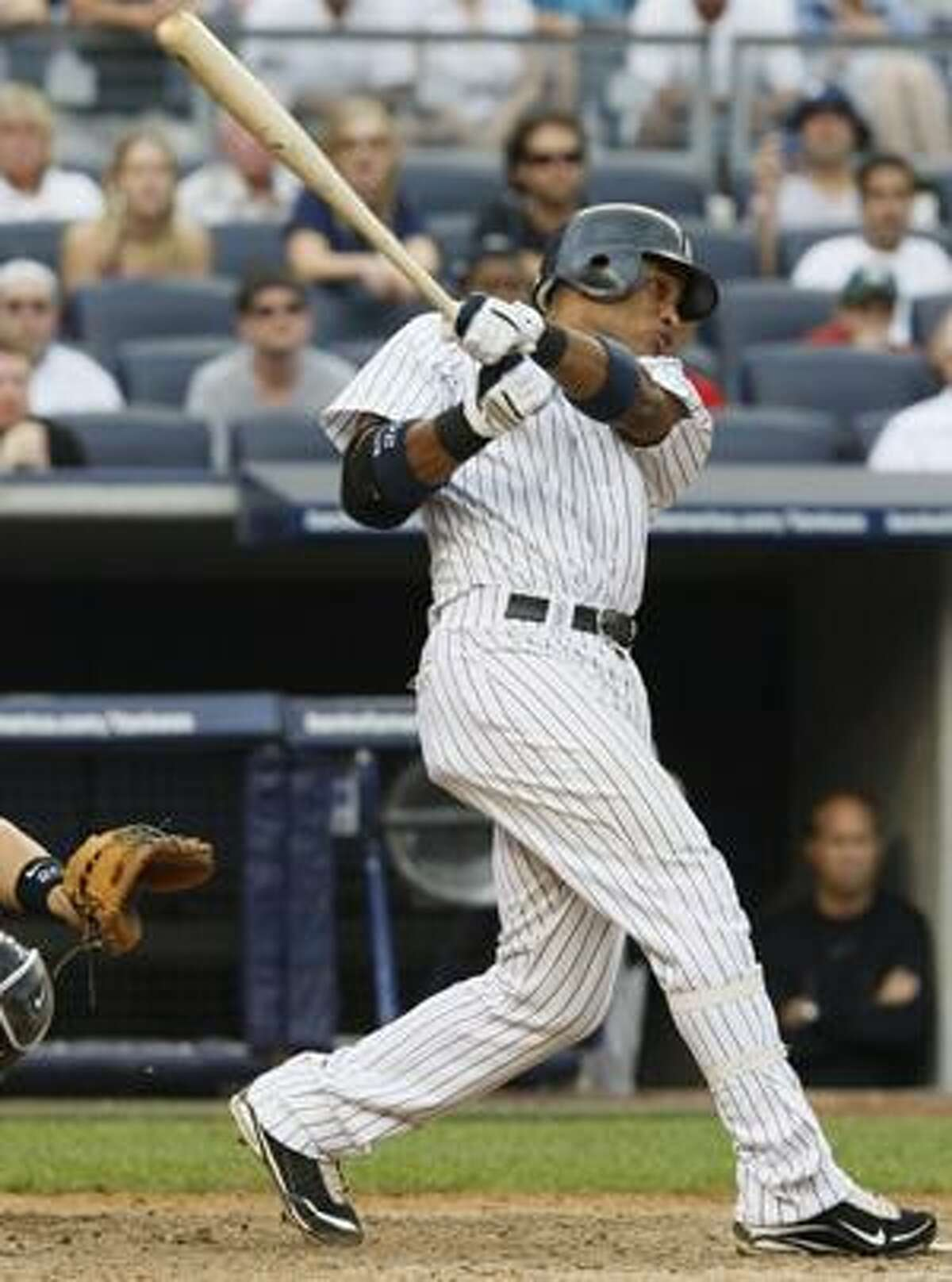 Robinson Cano delivers the game-winning RBI single in the 11th inning of the New York Yankees' 4-3 win over the Toronto Blue Jays at Yankee Stadium Wednesday.