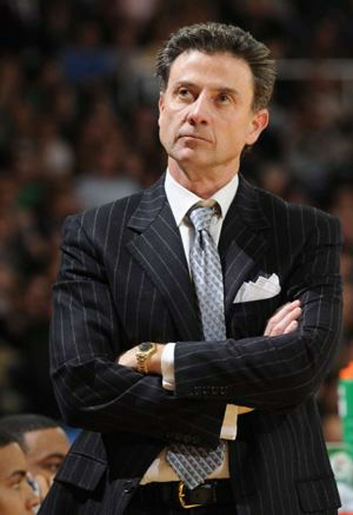 This is a Feb. 12 file photo showing Louisville coach Rick Pitino reacting during the closing minutes of a 90-57 loss to Notre Dame in an NCAA college men's basketball game in South Bend, Ind. Pitino told police he had sex in a restaurant six years ago with a woman now accused of trying to extort millions of dollars from him. And when she told him two weeks later she was pregnant, he gave her $3,000 for an abortion.