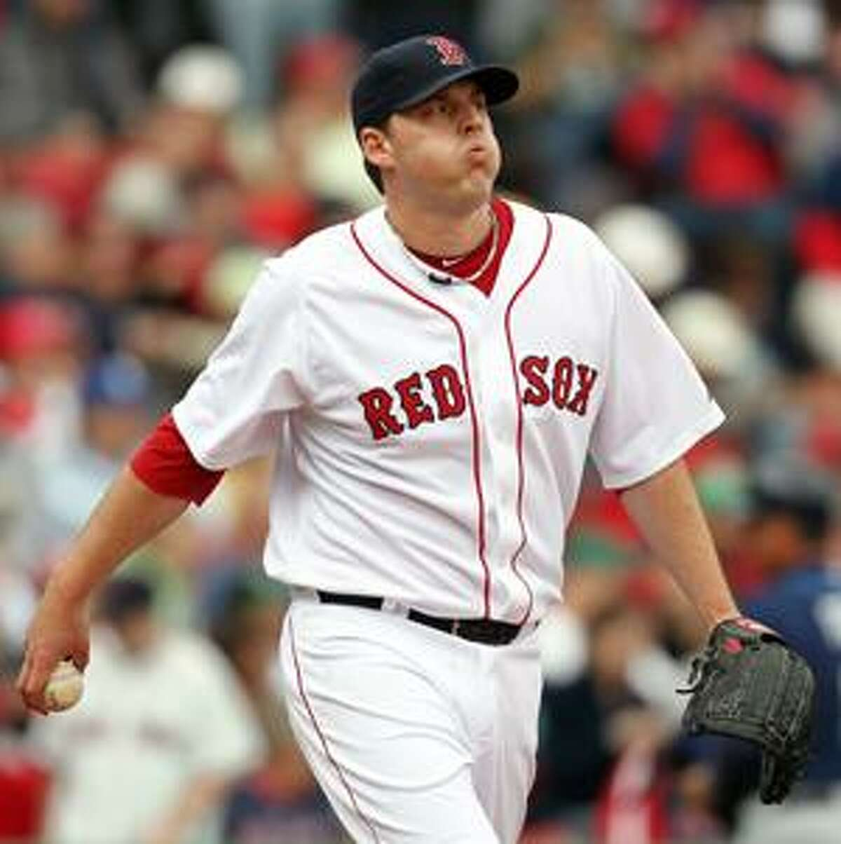 Boston Red Sox starting pitcher John Lackey walks back to the mound just before being pulled out of the game during the fourth inning against the Tampa Bay Rays in a MLB baseball game at Fenway Park in Boston Monday, April 19, 2010. (AP Photo/Winslow Townson)