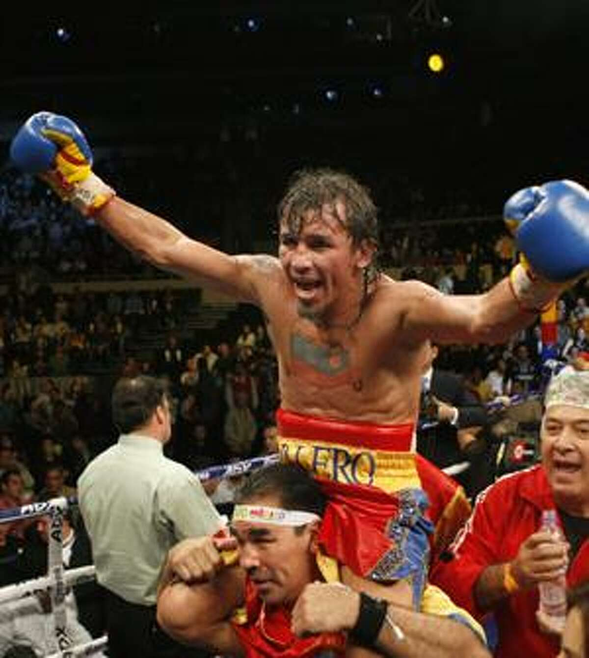 In this photo taken Feb. 6, 2010 Venezuela's Edwin Valero celebrates his victory over Mexico's Antonio DeMarco at a WBC lightweight title fight in Monterrey, Mexico. Valero committed suicide in his jail cell on Monday, April 19, 2010, in Valencia, Venezuela, just hours after he was arrested in his wife's killing, police said. (AP Photo/Eduardo Verdugo)