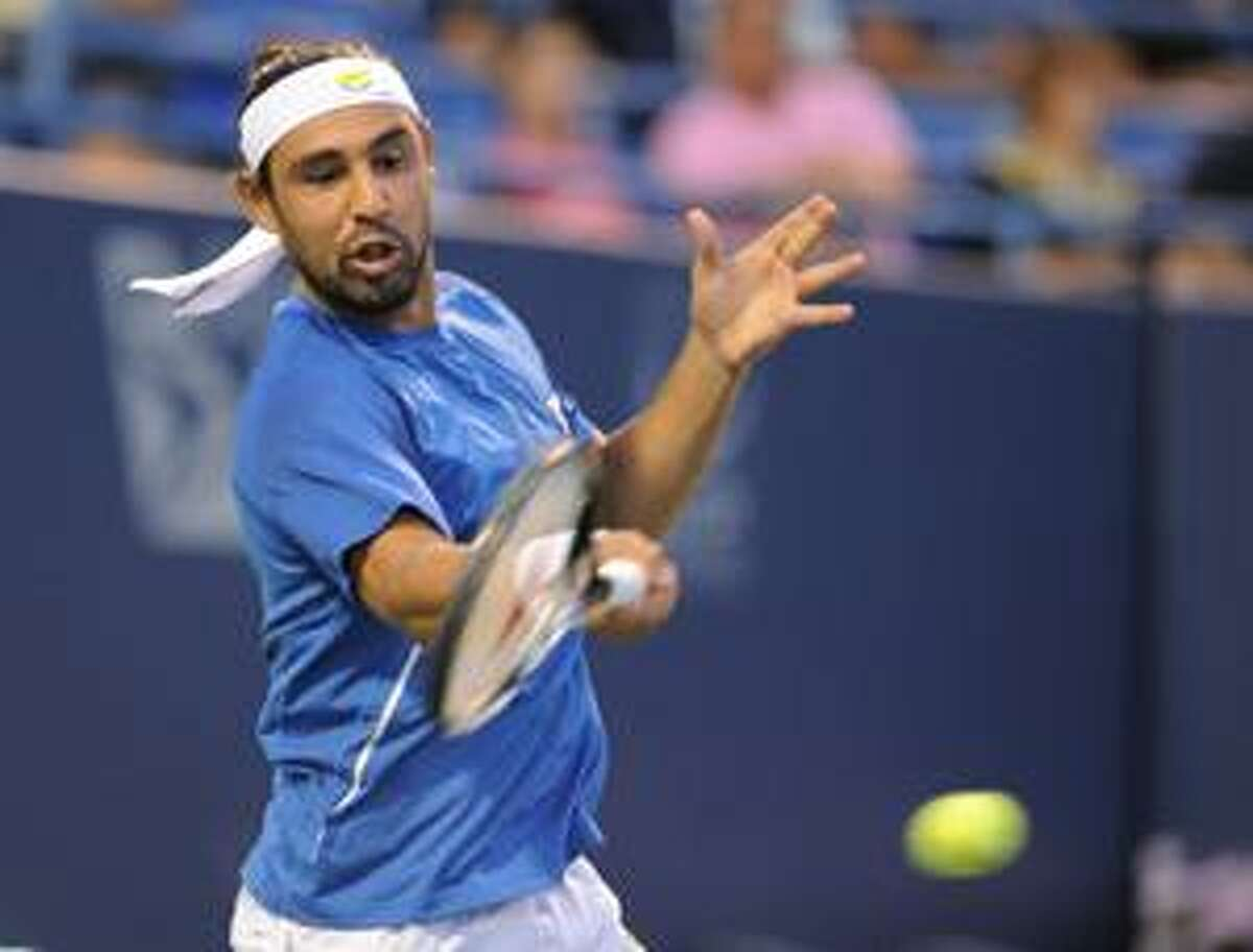 Marcos Baghdatis, of Cyprus, hits a forehand during his match against Sergiy Stakhovsky, of Ukraine, at the Pilot Pen tennis tournament in New Haven, Conn., on Thursday, Aug. 26, 2010. (AP Photo/Fred Beckham)