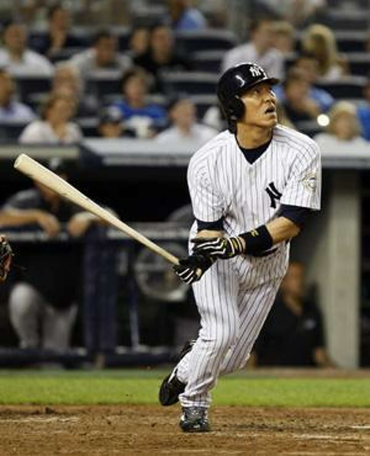 New York Yankees Hideki Matsui reacts as he flies out with Robinson Cano at first for the third out in the fifth inning of the Yankees' game against the Toronto Blue Jays at Yankee Stadium Tuesday.