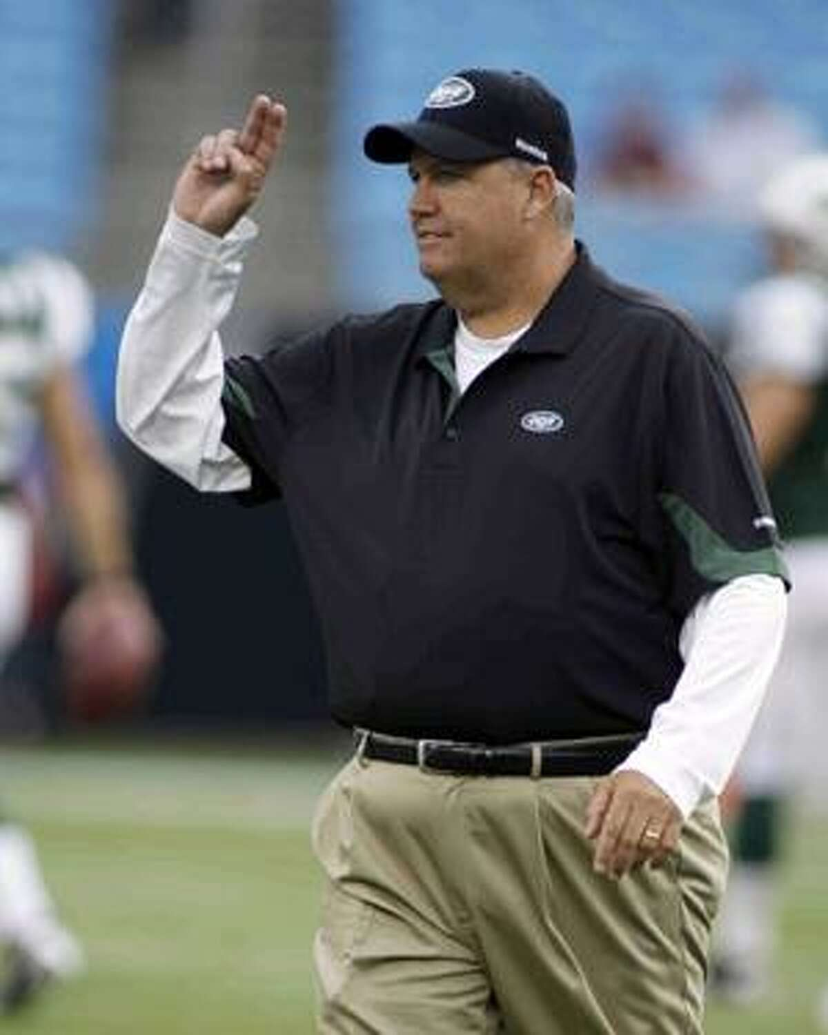 New York Jets head coach Rex Ryan waves at fans before a preseason NFL football game against the Carolina Panthers in Charlotte, N.C., Saturday, Aug. 21, 2010. (AP Photo/Rick Havner)