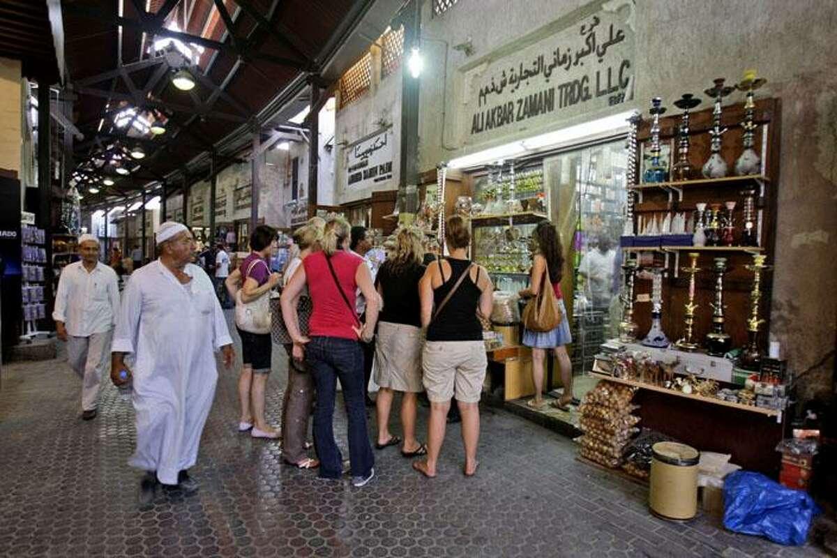 On July 22, tourists visit a spice shop at Morshed Bazar in Dubai, United Arab Emirates.