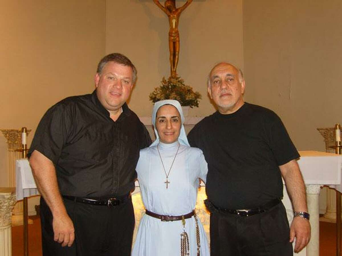 DAN IVERS/Register Citizen From left, St. Maron's deacon Steven Marcus, Sister Olga Yaqob, and Father Larry Michael, at the church on Sunday.