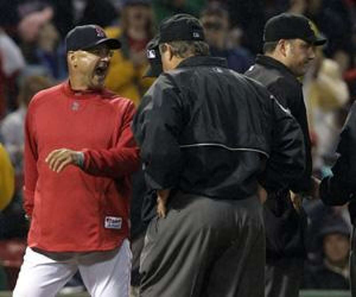 Boston Red Sox manager Terry Francona yells at the umpires after being ejected for arguing a strikeout call on Adrian Beltre, between the second and third innings of the second baseball game of a day-night doubleheader against the Seattle Mariners at Fenway Park in Boston on Wednesday, Aug. 25, 2010. Both Beltre and Francona were ejected from the game. (AP Photo/Elise Amendola)