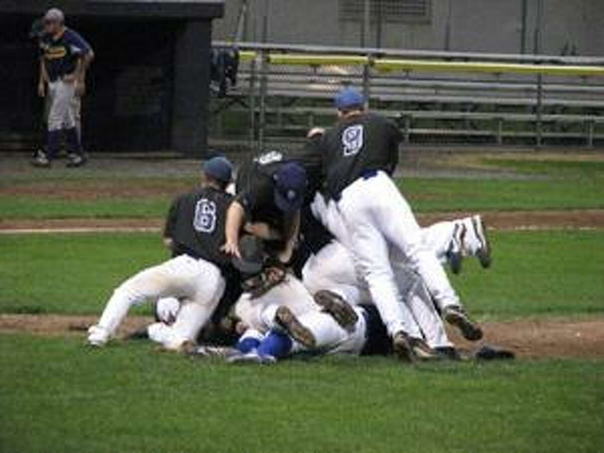 Submitted photo Members of the Bethlehem Plowboys celebrate on the mound moments after capturing the Tri-State Baseball Championship at Fuessenich Park on Wednesday with a 2-1 victory over the Tri-Town Trojans.