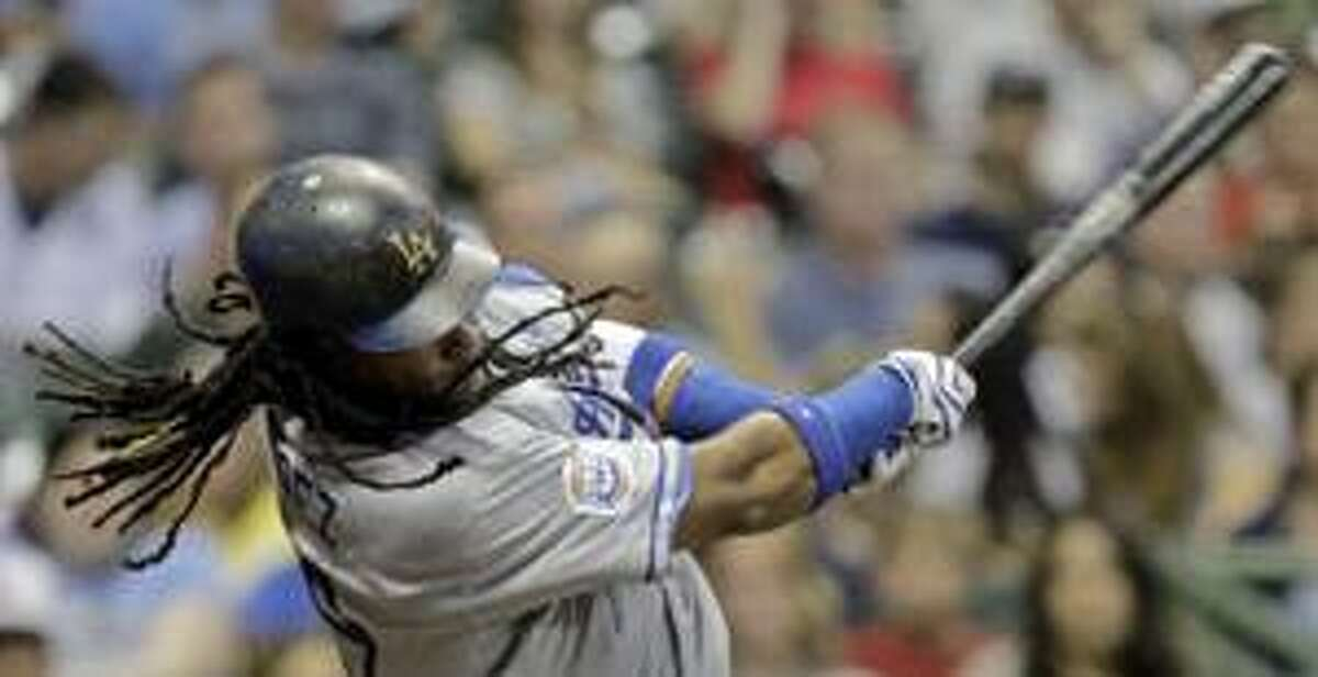 Los Angeles Dodgers' Manny Ramirez hits a double during the third inning of a baseball game against the Milwaukee Brewers, Wednesday, Aug. 25, 2010, in Milwaukee. (AP Photo/Morry Gash)