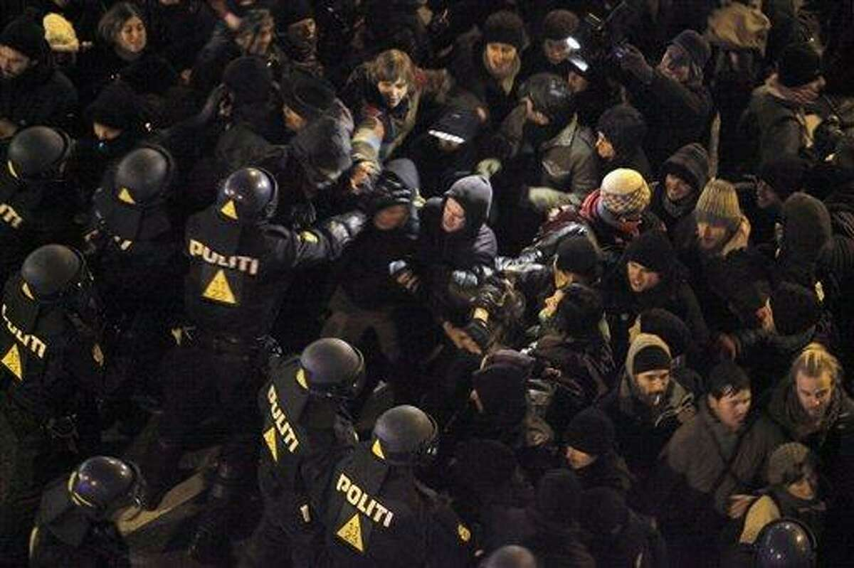 Danish riot police guards scuffles with demonstrators in Copenhagen Saturday Dec. 12, 2009. The largest and most important U.N. climate change conference is underway in Copenhagen, aiming to secure an agreement on how to protect the world from calamitous global warming. (AP Photo/Thibault Camus)