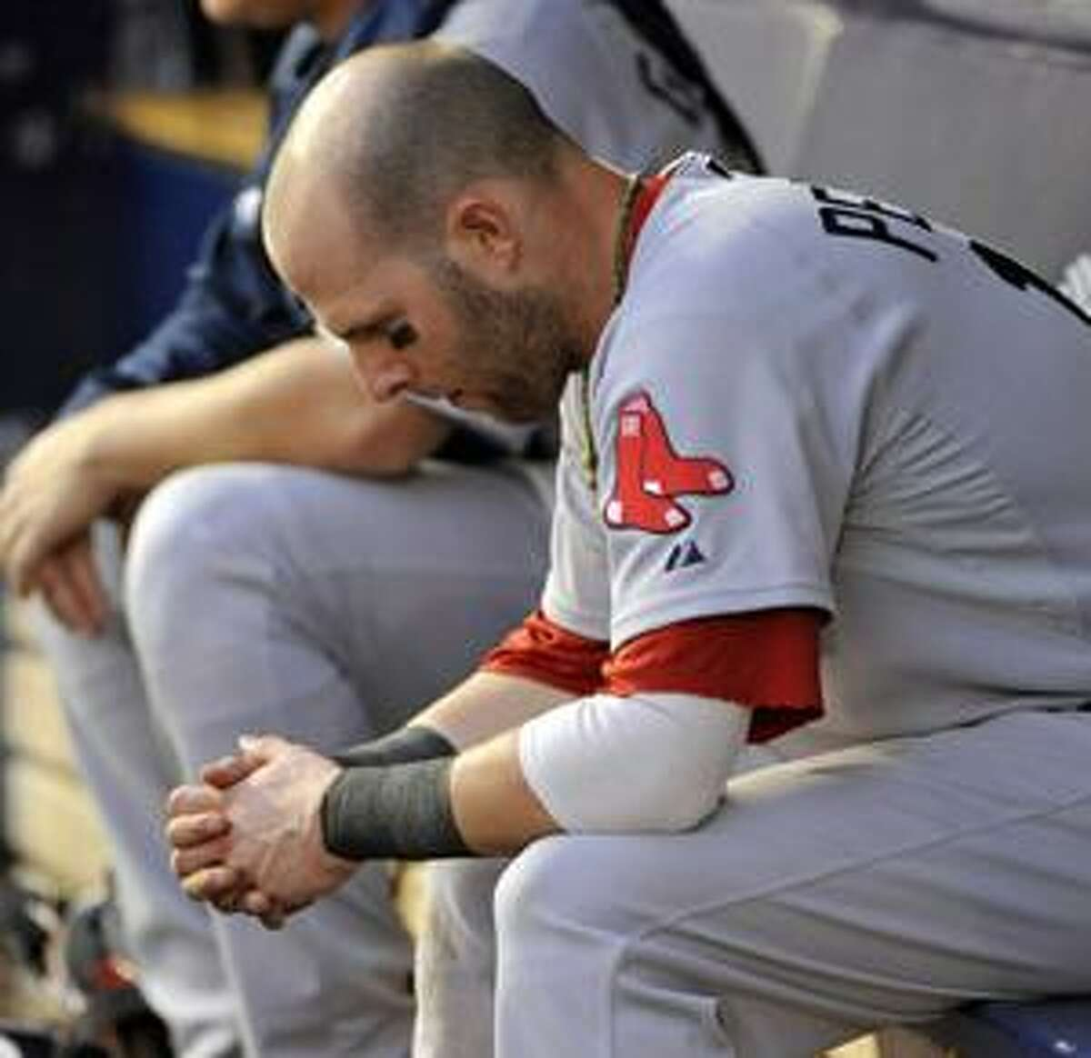 AP Boston Red Sox Dustin Pedroia sits on the bench during the ninth inning against the New York Yankees Saturday at Yankee Stadium.