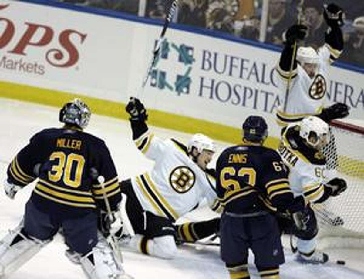 Buffalo Sabres goalie Ryan Miller and Tyler Ennis (63) look on as Boston Bruins' Michael Ryder, top right, celebrates his goal with teammate Vladimir Sobotka (60) and Andrew Ference, center, after a Bruins goal during the third period of a first-round NHL playoff hockey game in Buffalo, N.Y., Saturday, April 17, 2010. The Bruins won 5-3. (AP Photo/ Dean Duprey)