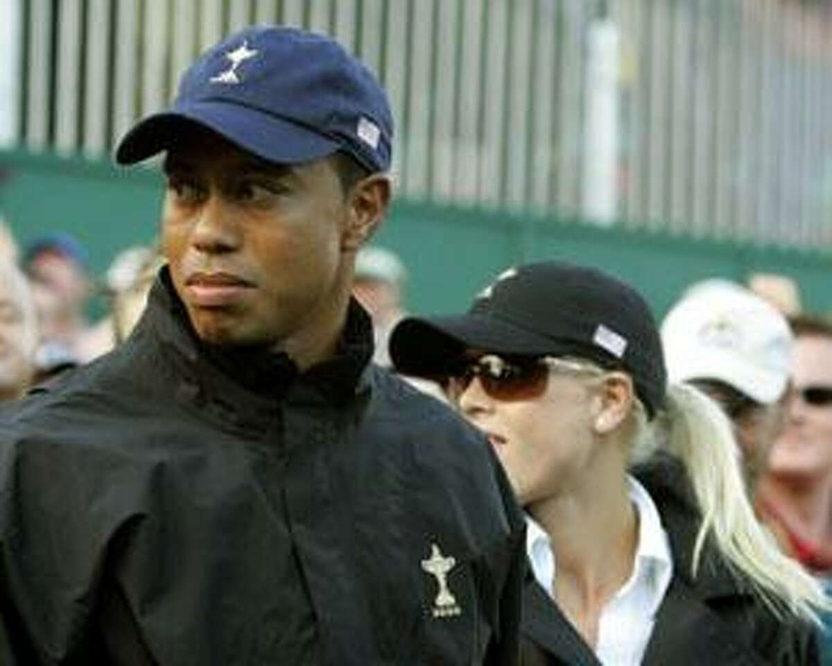 AP In this Sept. 26, 2006, file photo, Tiger Woods and his wife Elin walk away the 16th green as European players celebrate on the last day of the Ryder Cup at the K Club golf course, Straffan, Ireland. On his web site Friday night, Woods announced that he is taking an indefinite break from professional golf.