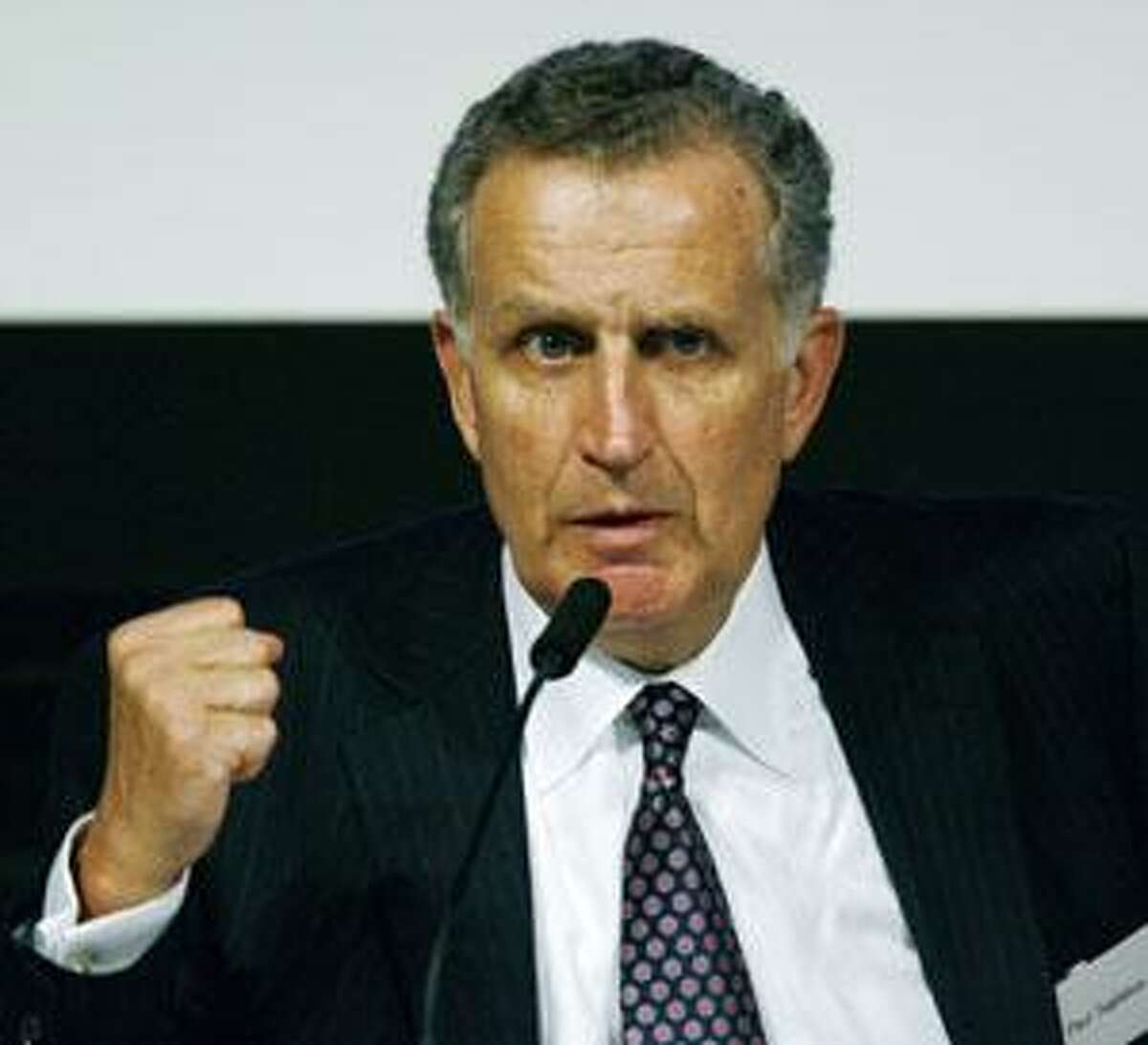 AP Former NFL commissioner Paul Tagliabue speaks at a news conference in Tokyo in this Sept. 11, 2008, file photo. He once oversaw one of America's most successful sports operations. Now, he's trying to find solutions for one of its most dysfunctional.
