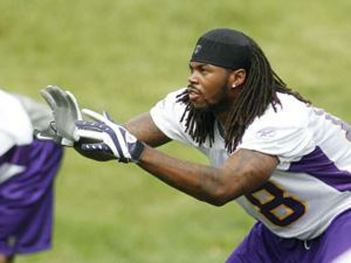Minnesota Vikings wide receiver Sidney Rice prepares to catch a football during NFL football training camp in Eden Prairie, Minn., Thursday, Aug. 19, 2010. (AP Photo/Andy King)