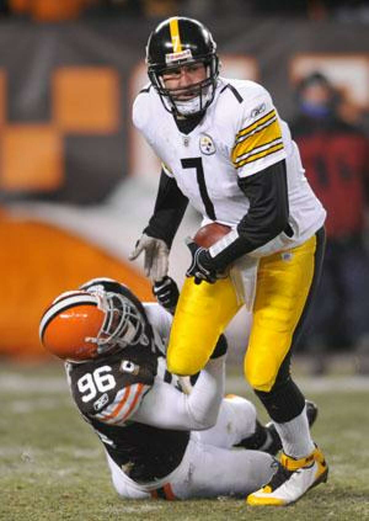 AP Pittsburgh Steelers quarterback Ben Roethlisberger (7) is sacked by Cleveland Browns linebacker David Bowens (96) in the third quarter of Thursday night's game in Cleveland. Roethlisberger was sacked eight times in the 13-6 loss to the Browns.