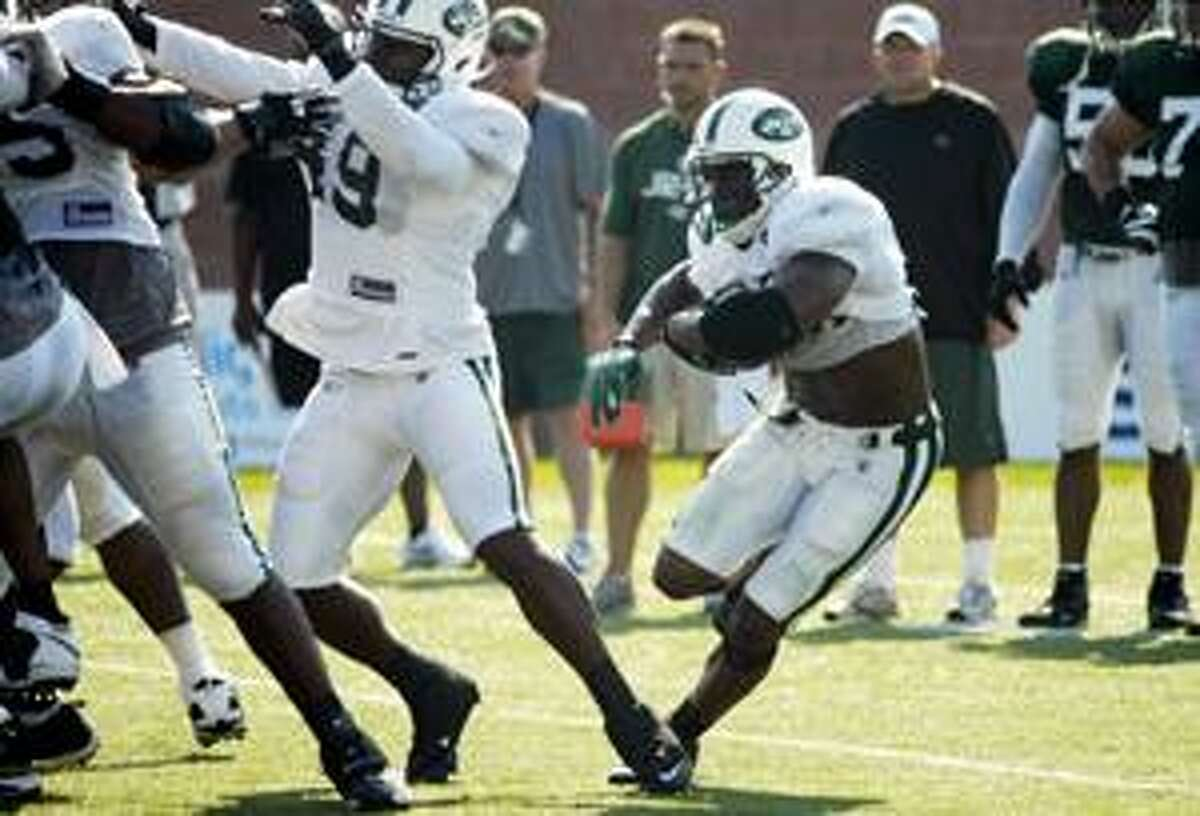 New York Jets running back Thomas Jones carries the ball during training camp in Cortland, N.Y., Aug. 1.