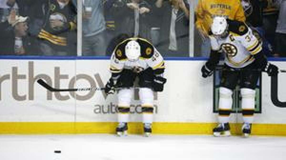 Boston Bruins' Zdeno Chara, right, of Slovakia and David Krejci, left, of Czech Republic, react near the end of the game against the Buffalo Sabres during the third period of a first-round NHL playoff hockey game in Buffalo, N.Y., Thursday, April 15, 2010. The Sabres won 2-1. (AP Photo/ David Duprey)