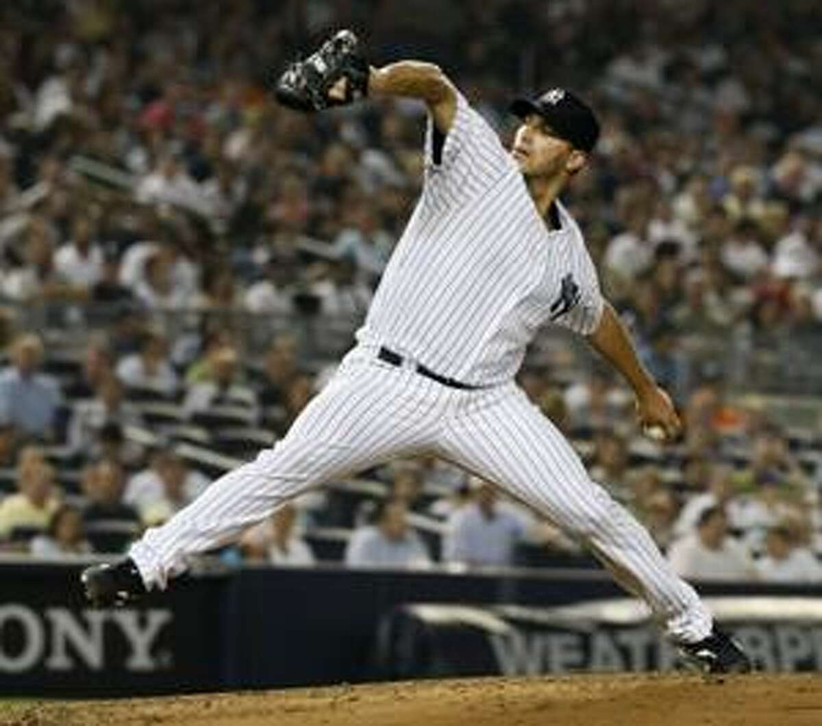 New York Yankees pitcher Andy Pettitte threw seven shutout innings against the Boston Red Sox Sunday night at Yankee Stadium in New York's 5-2 victory.