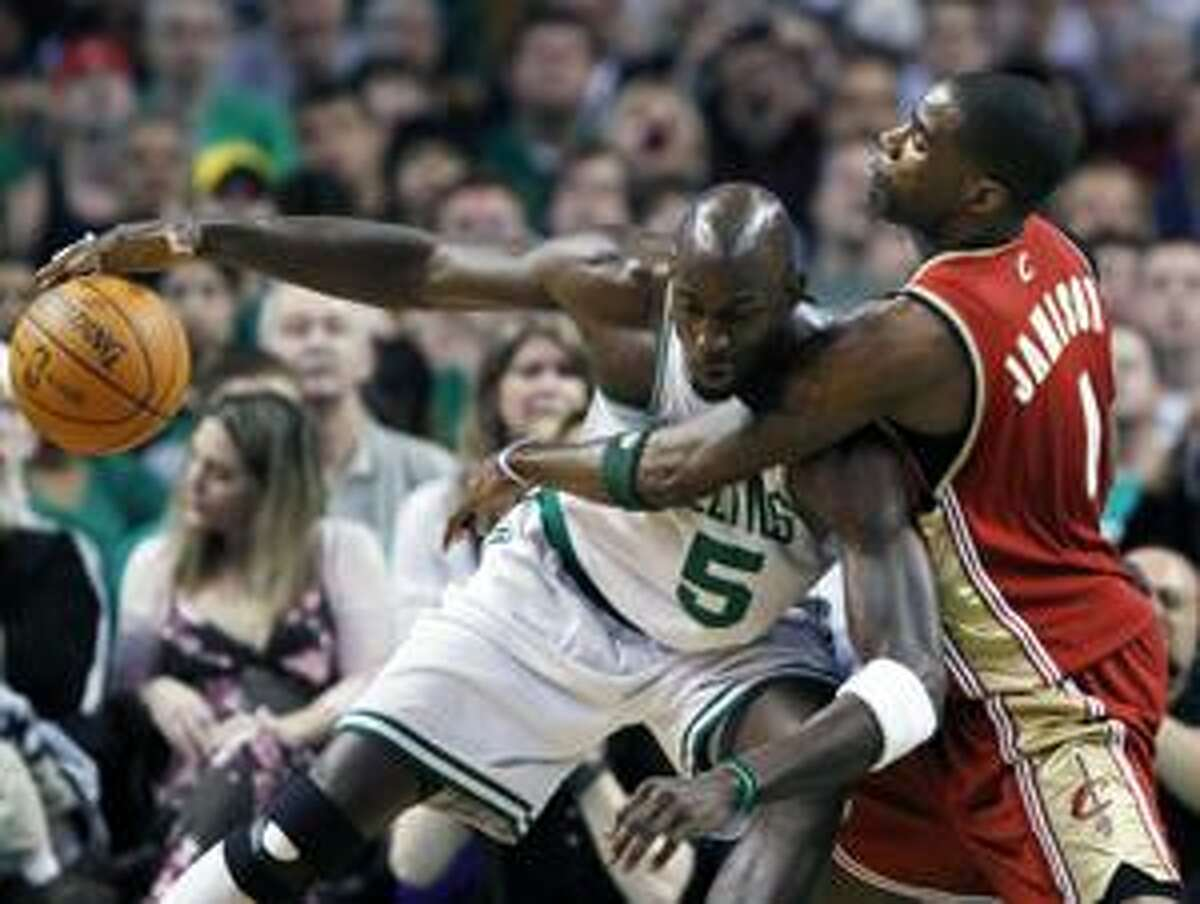 Boston Celtics' Kevin Garnett (5) keeps the ball away from Cleveland Cavaliers' Antawn Jamison in the first quarter of an NBA basketball game, Sunday, April 4, 2010, in Boston. (AP Photo/Michael Dwyer)