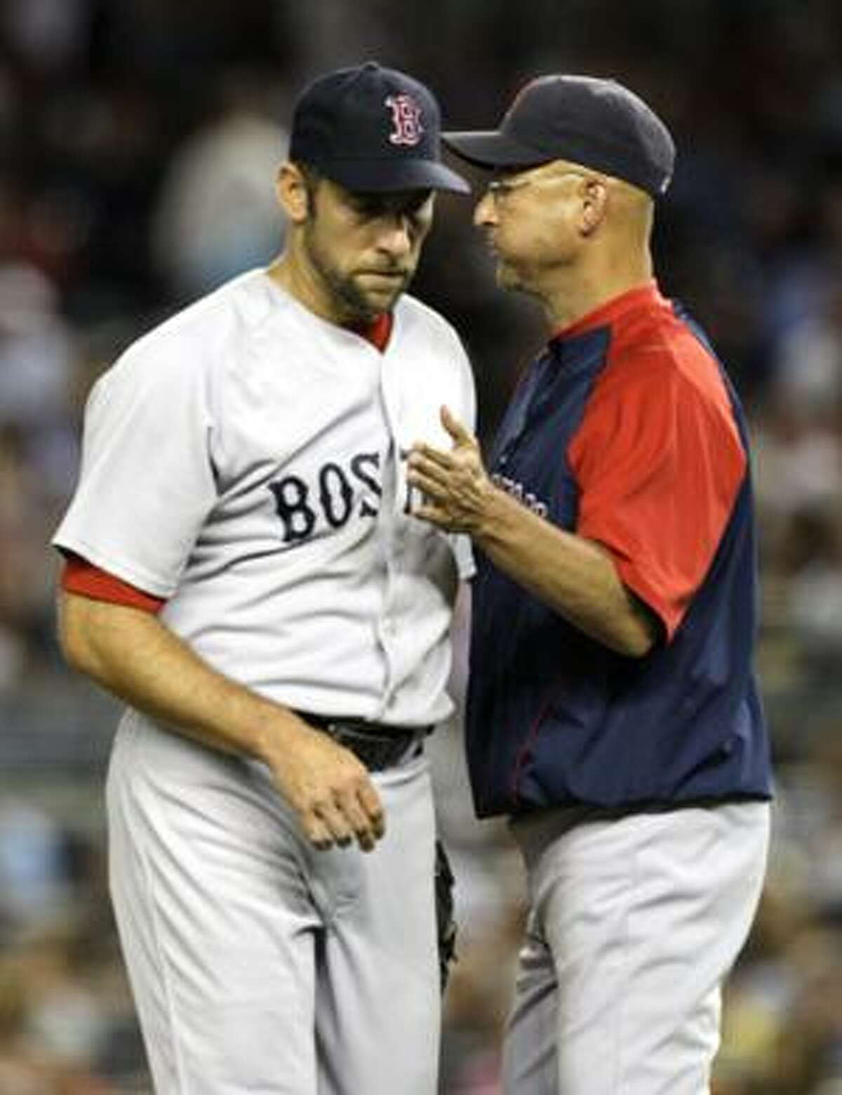 AP Boston Red Sox pitcher John Smoltz is taken out of Thursday's game against the New York Yankees in the fourth inning by manager Terry Francona. Smoltz was cut by Boston Friday.