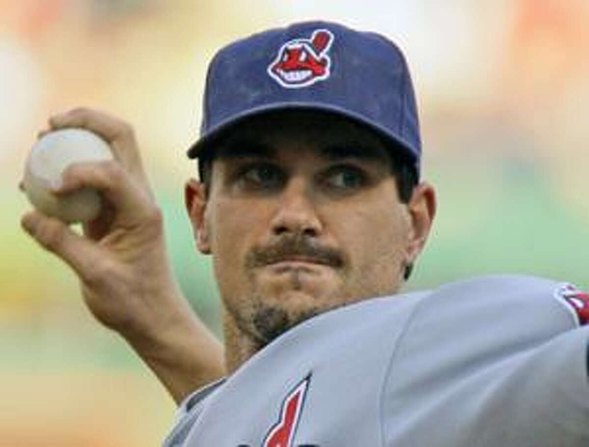 AP This is a June 24 file photo showing Cleveland Indians pitcher Carl Pavano delivering a pitch in the first inning against the Pittsburgh Piratesin Pittsburgh. The Minnesota Twins have acquired Pavano from the Cleveland Indians in an attempt to shore up their rotation. The deal was announced Friday.