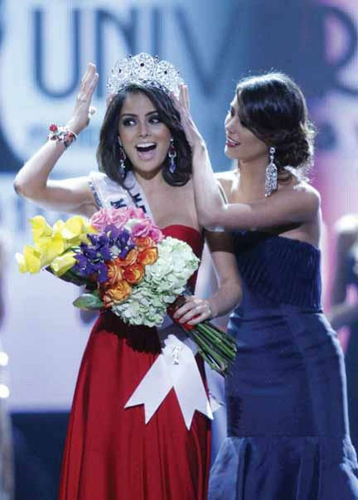 Miss Mexico Jimena Navarrete is crowned Miss Universe 2010 by Stefania Fernandez during the Miss Universe pageant, Monday, Aug. 23, 2010 in Las Vegas. (AP Photo/Isaac Brekken)