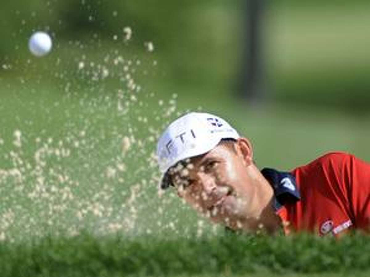AP Padraig Harrington, from Ireland, hits from the sand to the fourth green during the second round of the Bridgestone Invitational Friday at Firestone Country Club in Akron, Ohio.