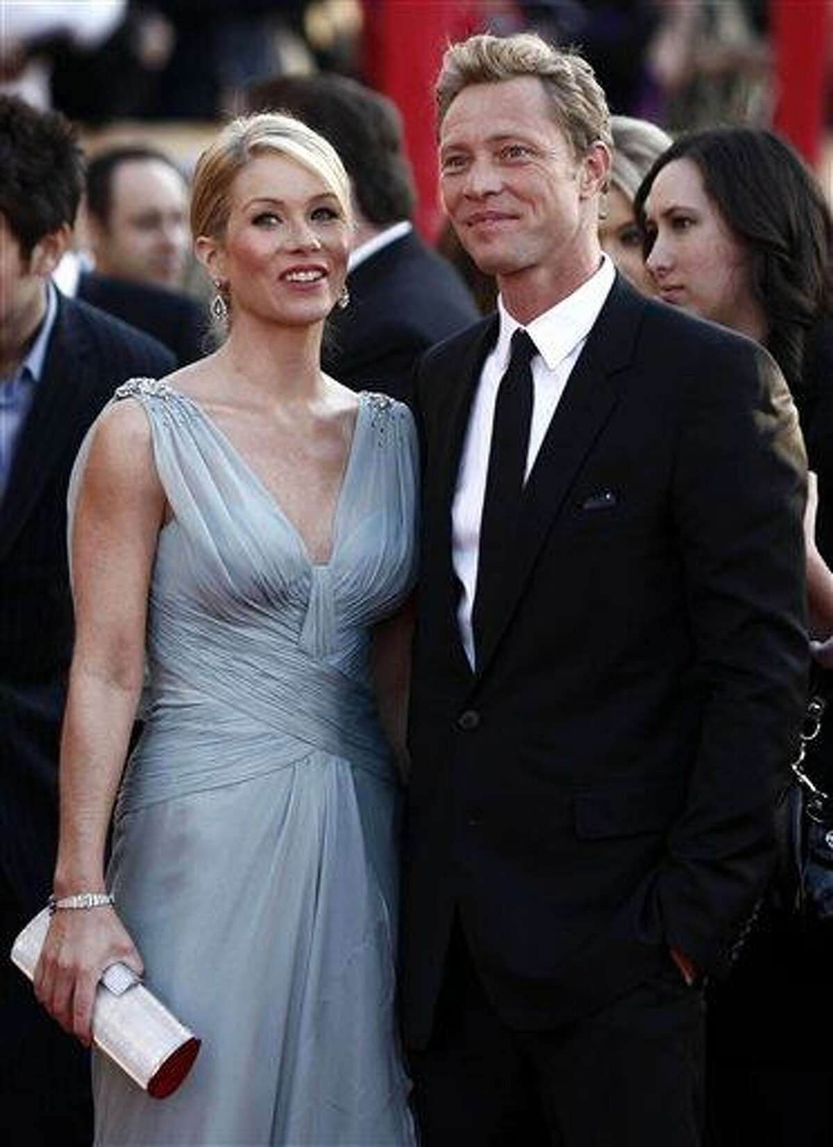 In this Jan. 23, 2010 file photo, Christina Applegate, left, and Martyn Lenoble arrive at the 16th Annual Screen Actors Guild Awards in Los Angeles.
