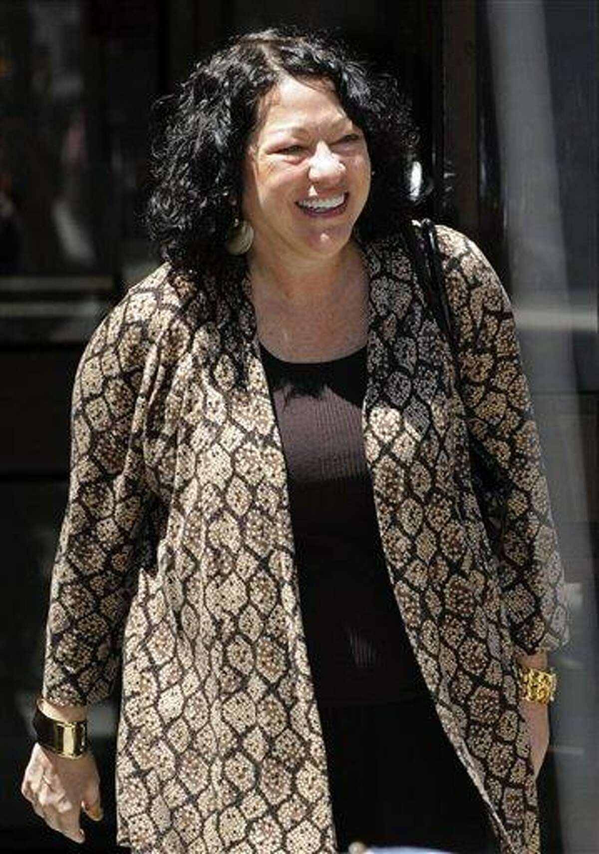 FILE - In this Aug. 7, 2009 file photo, Supreme Court designate Sonia Sotomayor leaves her West Village apartment in New York. (AP Photo/ Louis Lanzano, FILE)
