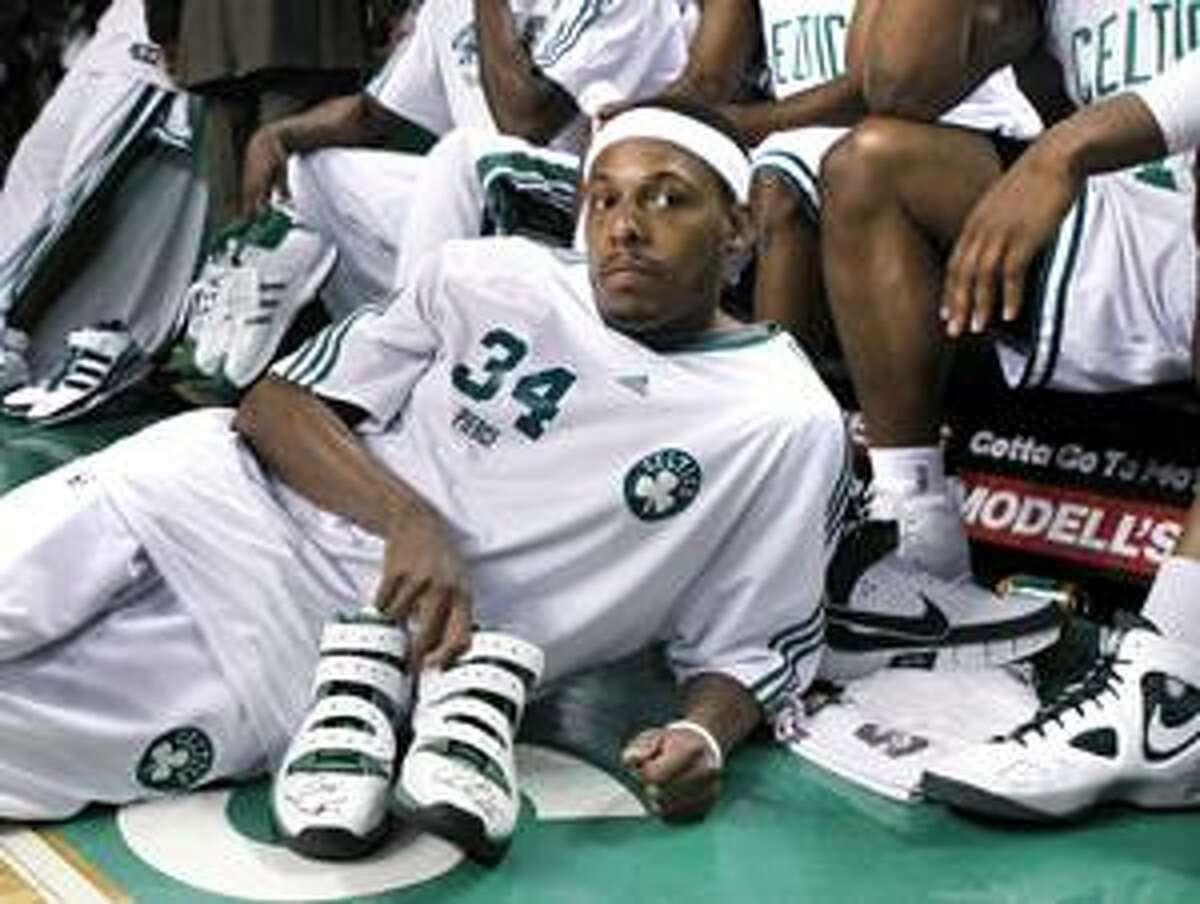 AP Boston Celtics forward Paul Pierce waits on the floor to give away a pair of his autographed sneakers to a fan during Fan Appreciation Day after the Celtics' game against the Milwaukee Bucks in Boston on Wednesday. Boston takes on Miami in the first round of the playoffs.