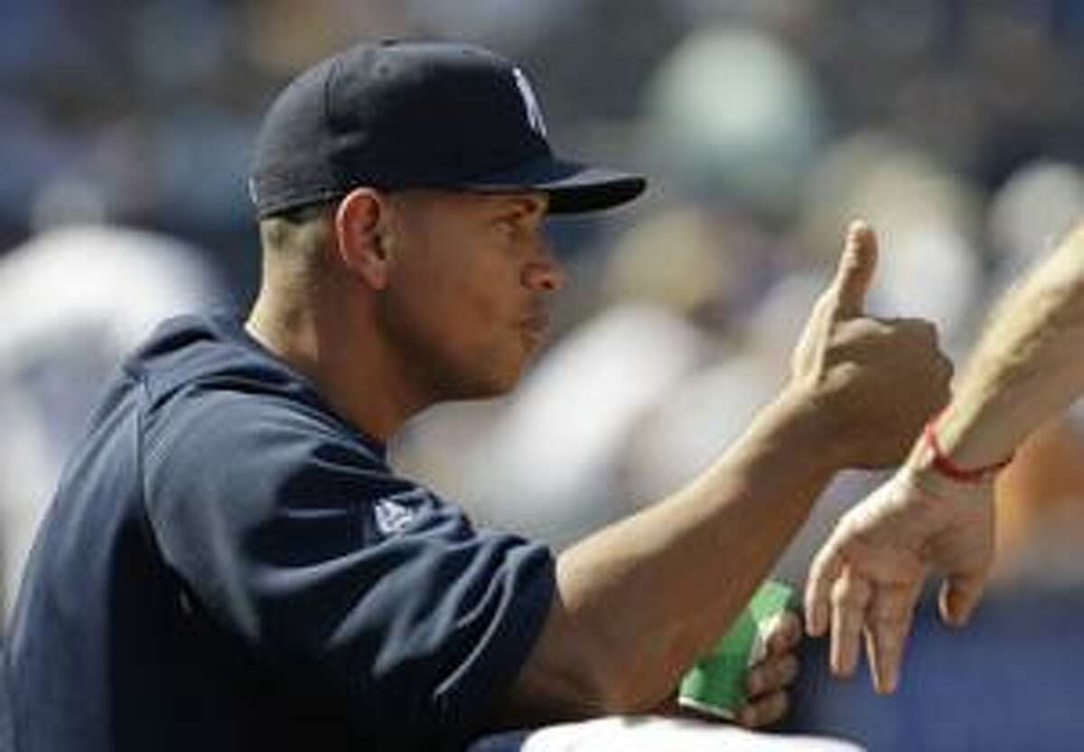 AP New York Yankees third baseman Alex Rodriguez gives a thumbs up sign of approval during the sixth inning of an Aug. 19 game against the Detroit Tigers at Yankee Stadium in New York.