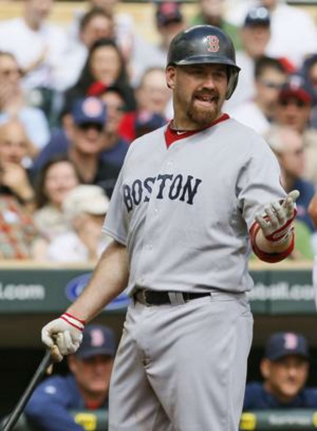 AP Boston Red Sox infielder Kevin Youkilis disagrees after he is called out on strikes against Minnesota Twins pitcher Francisco Liriano during the first inning of Thursday's game in Minneapolis. The Twins beat the Red Sox 8-0.