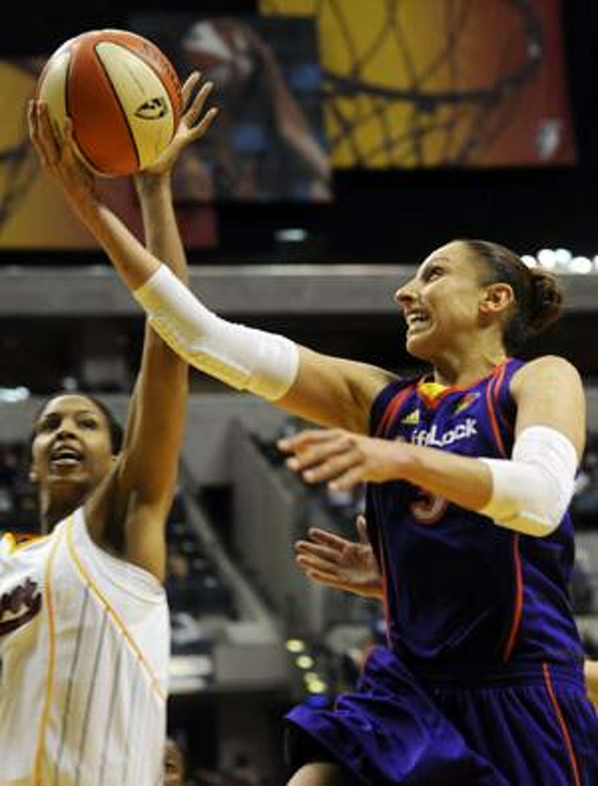 AP Phoenix Mercury guard Diana Taurasi is defended by Indiana Fever center Tammy Sutton-Brown in the second half of an Aug. 13 game in Indianapolis. Indiana won 110-90.