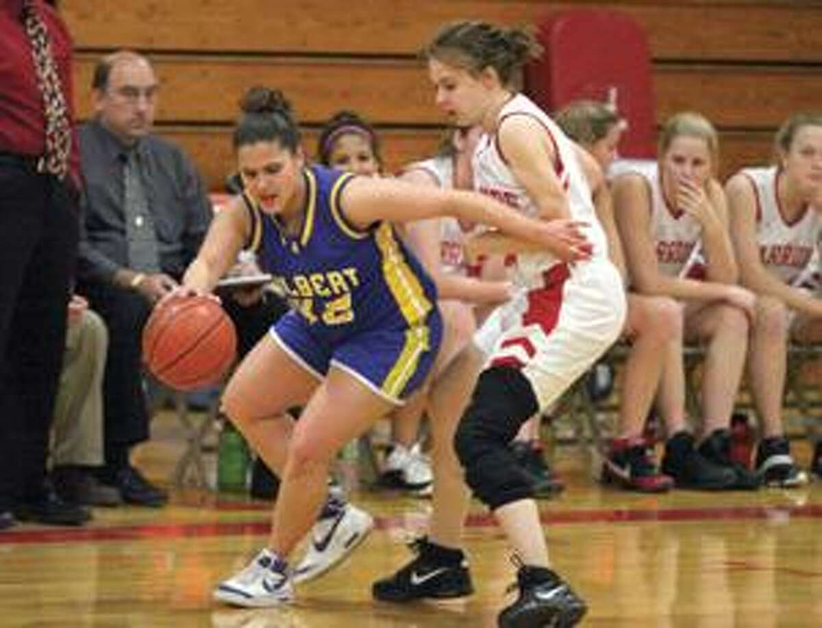 Gilbert's Francesca Marino pushes past Wamogo's Katie Koley Thursday during their Berkshire League game in Litchfield.