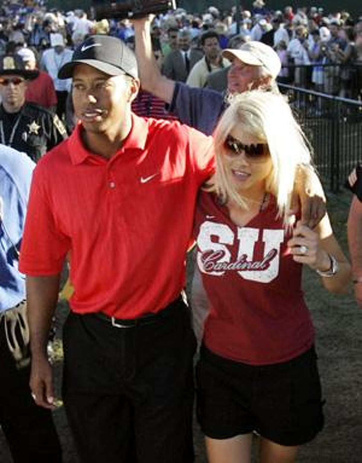 In this Aug. 20, 2006, file photo, Tiger Woods celebrates with wife Elin Nordegren after winning the 88th PGA Championship golf tournament at Medinah Country Club in Medinah, Ill. Woods and his wife are officially divorced. The lawyers for Woods and Nordegren said in a statement that the divorce became official Monday, in Bay County Circuit Court, in Panama City,Fla. (AP Photo/Rob Carr, File)
