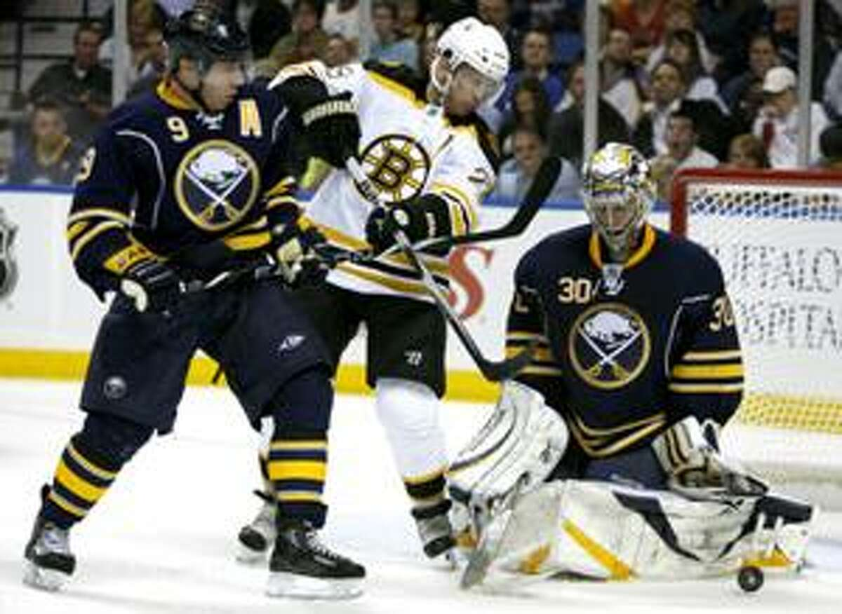 AP Buffalo Sabres goalie Ryan Miller stops a shot under pressure from Boston Bruin Mark Recchi (28) as Sabres' Derek Roy (9) defends during the second period of a first-round NHL playoff game in Buffalo, N.Y., Thursday.